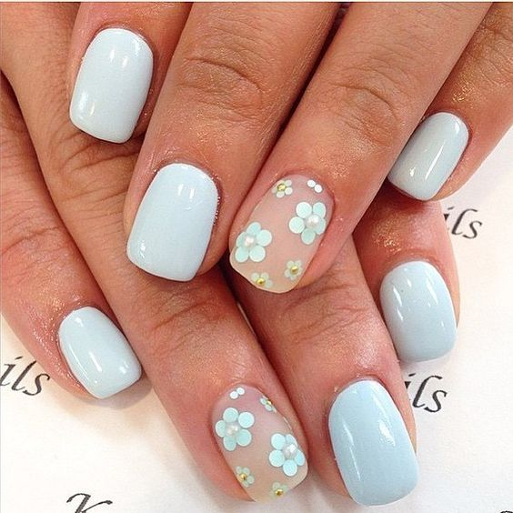 powder blue manicure and two accent nails with a matte finish and powder blue flowers