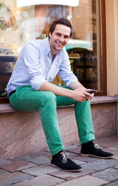 With pastel color shirt and black suede shoes