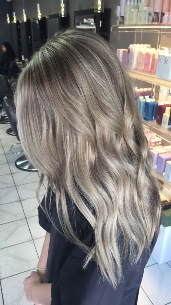 dimensional ashy blonde hair with waves