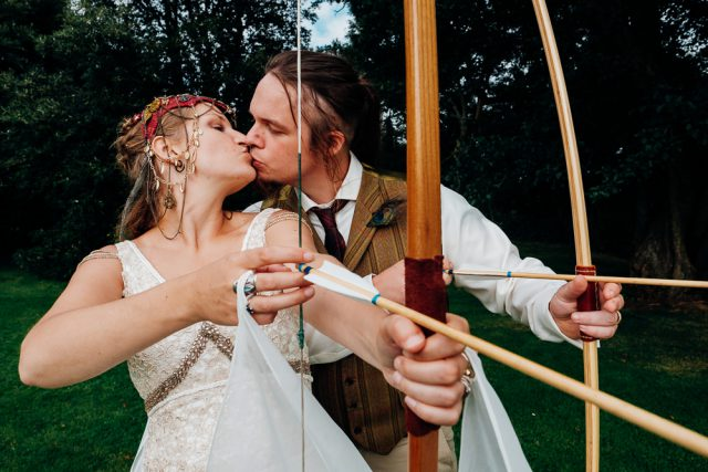 Archery was one of the wedding fun activities, isn't that unique