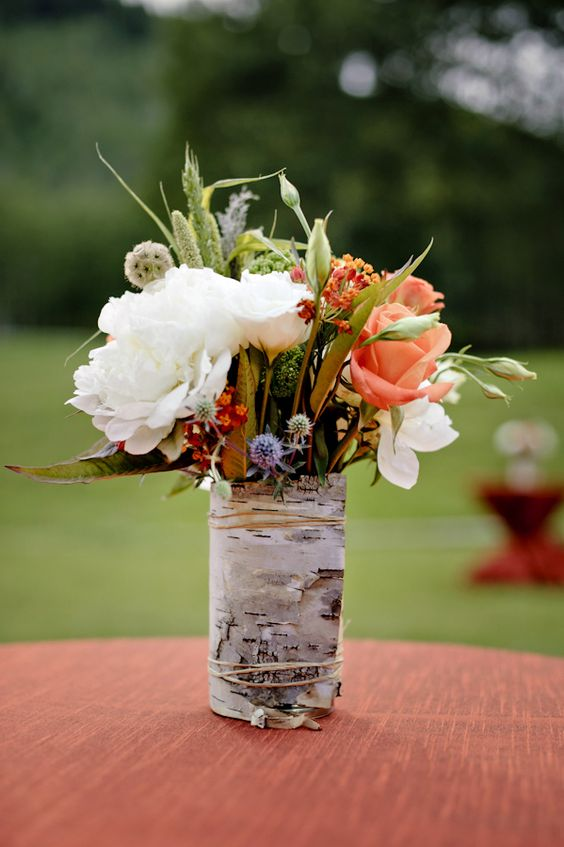 wrap vases with birch bark to give the arrangements a rustic look