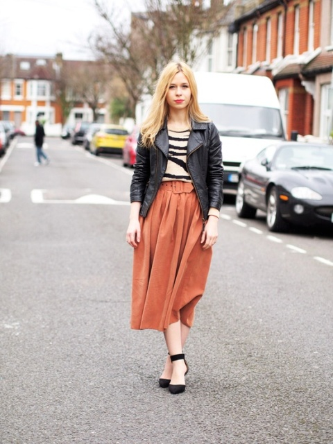 With printed shirt, leather jacket and black shoes