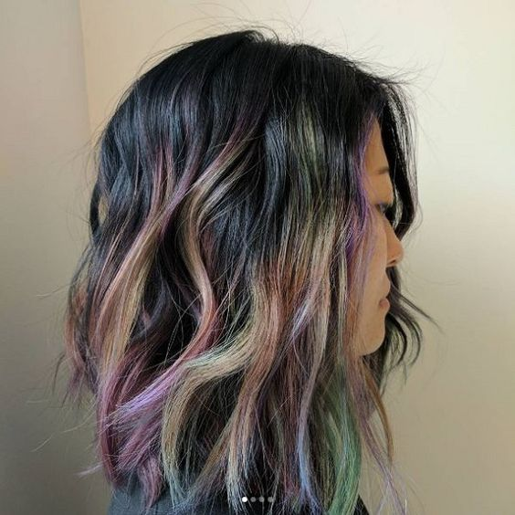 black hair with green and purple touches