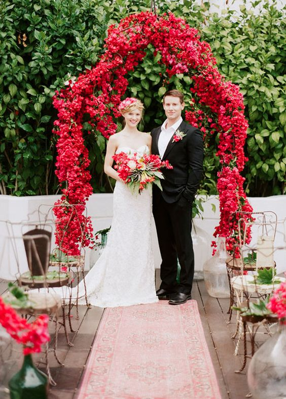 hot red floral wedding arch is a great choice to embrace the season