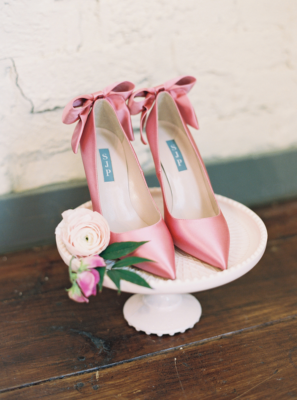 pink satin wedding shoes - photo by Jessica Gold Photography http://ruffledblog.com/vibrant-summer-wedding-inspiration-with-fun-colors