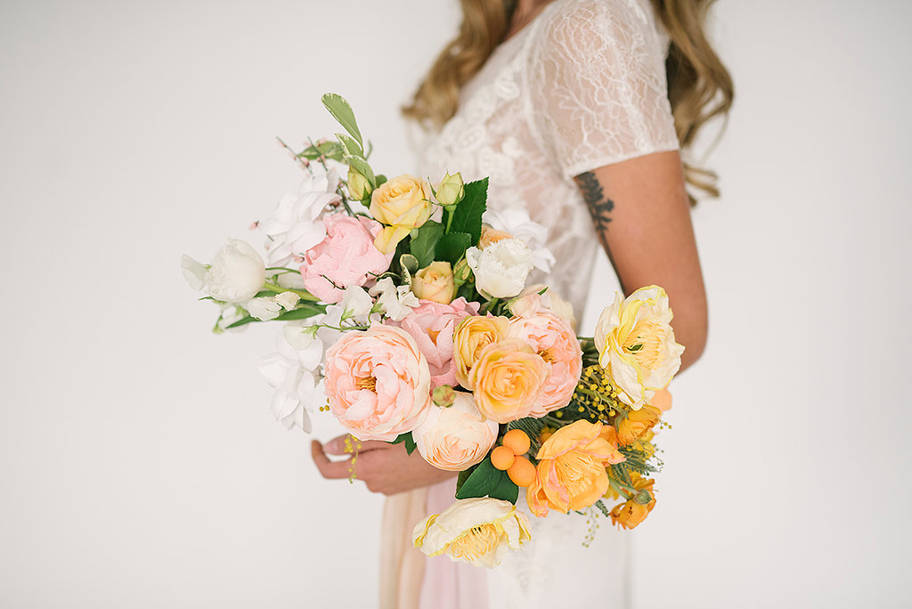 paper flower bouquets poppies - photo by Ashlee Brooke Photography http://ruffledblog.com/summertime-citrus-wedding-inspiration
