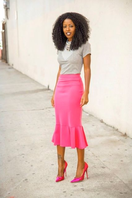 With gray shirt and hot pink pumps