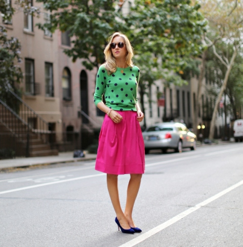 With green polka dot shirt and navy blue pumps