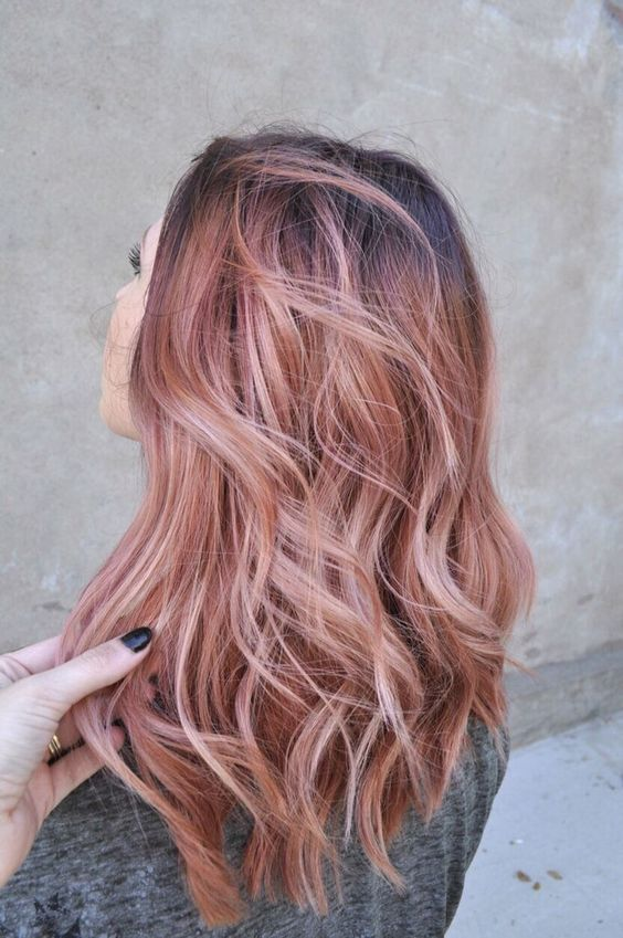 blorange balayage on dark hair looks refreshing and bold