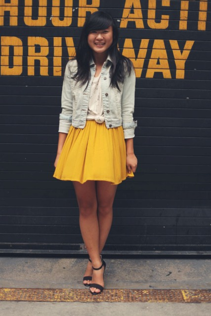With white shirt, crop denim jacket and heels