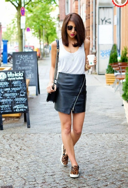 With white top, leather mini skirt and bag