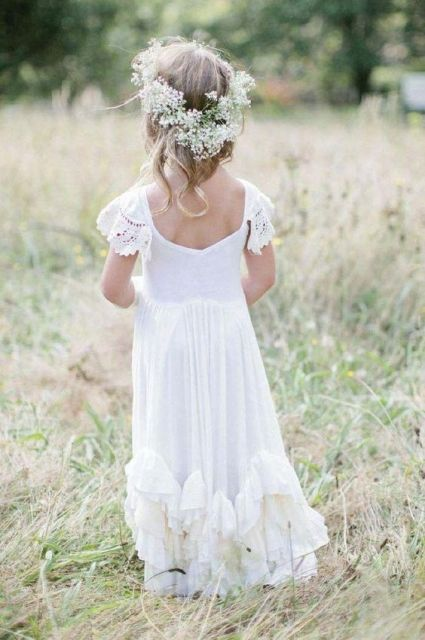 a white maxi dress with crochet lace cap sleeves and a ruffle skirt