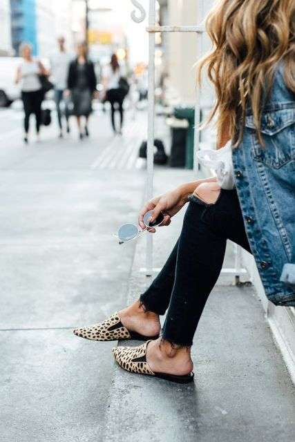 With denim jacket and dark color jeans