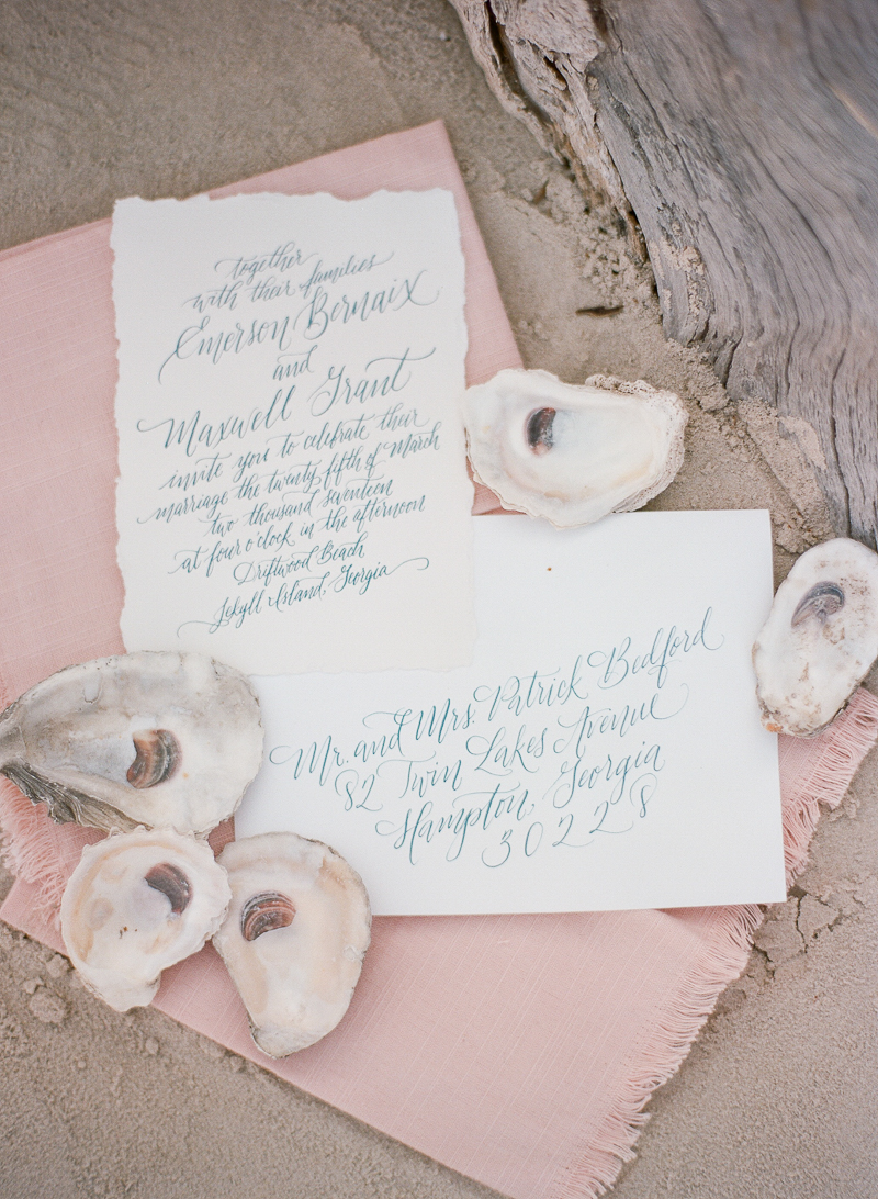 romantic wedding invitations - photo by The Ganeys http://ruffledblog.com/intimate-wedding-inspiration-on-driftwood-beach