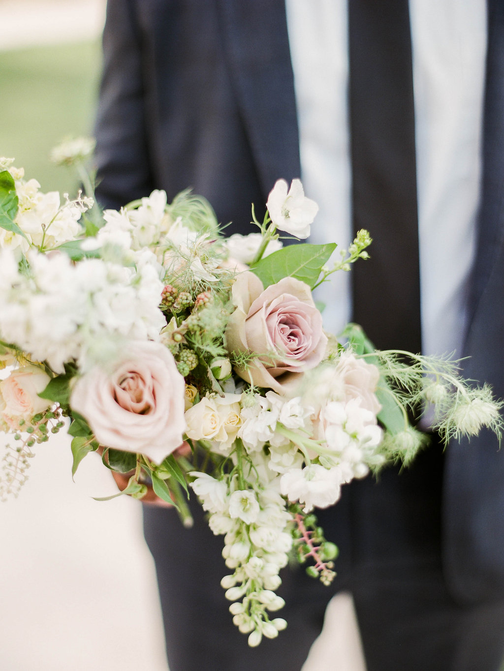 dusty pink rose bouquets - photo by Shannon Duggan Photography http://ruffledblog.com/elegant-chateau-wedding-inspiration-in-st-louis