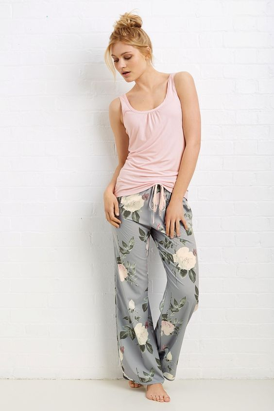 a set of pjs with a blush top and grey floral pants