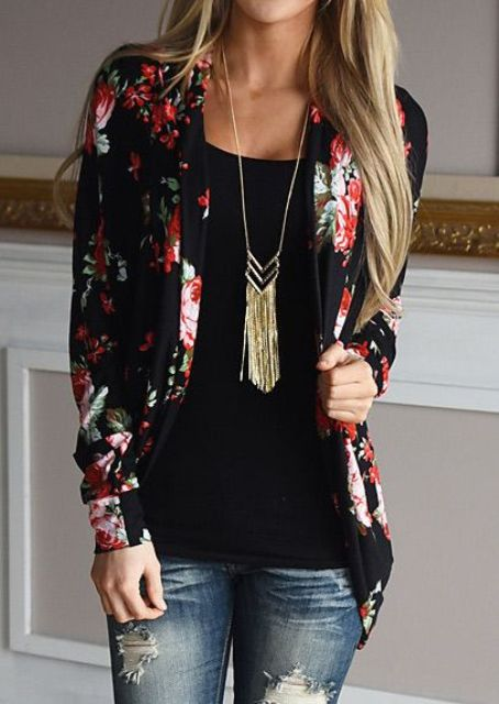 distressed jeans, a black top and a black floral blazer