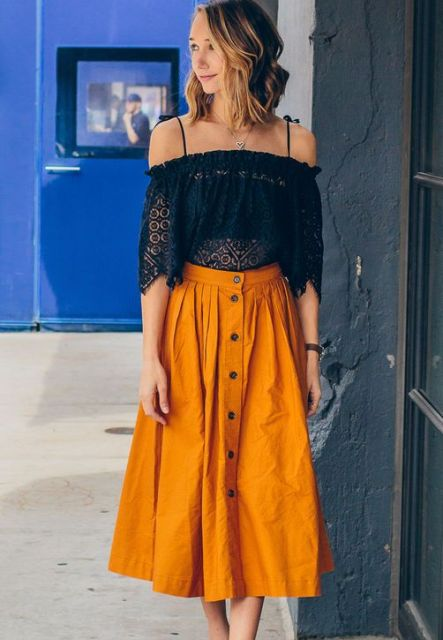 With navy blue off the shoulder blouse