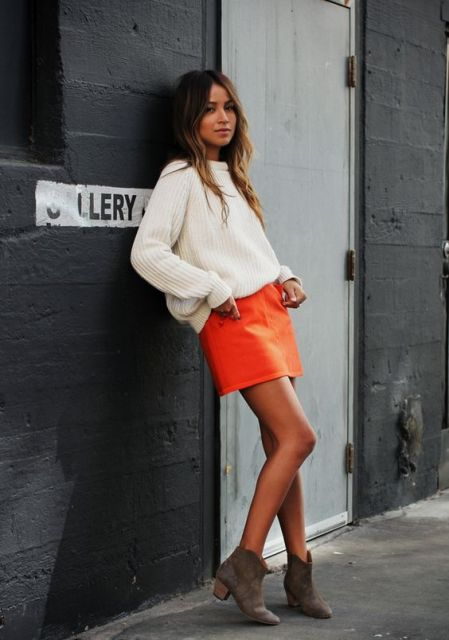 With oversized sweater and ankle boots