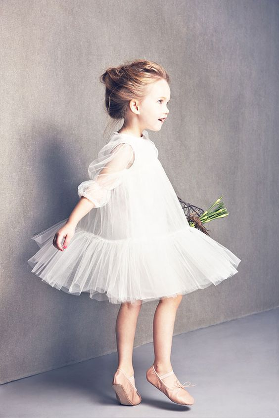 flowy white tulle dress with half sleeves and a ruffled skirt