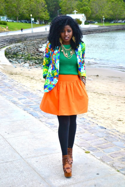 With green shirt, colorful jacket, black tights and platform shoes