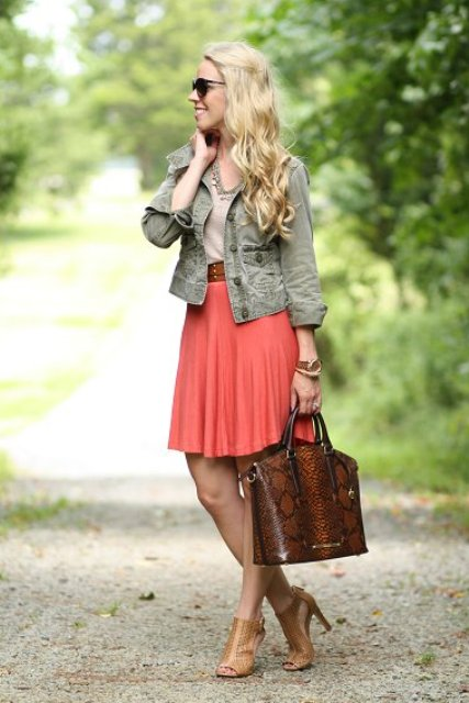 With olive green jacket, brown shoes and printed bag