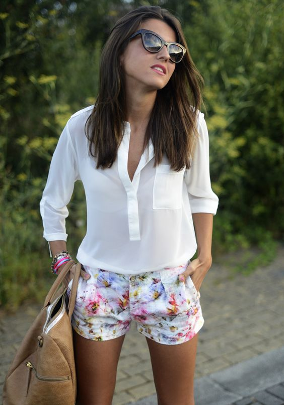 a white shirt with a pocket and cute floral shorts, a large tote