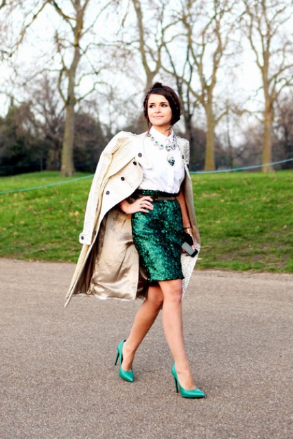 With white blouse, sequin skirt and trench coat
