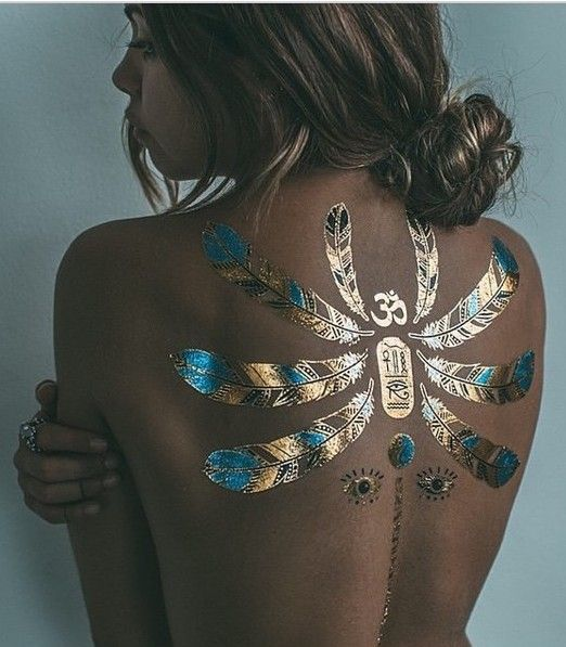 scarab and feather gold and black henna tattoo on the back