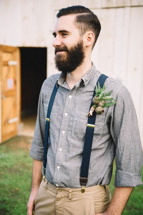 neutral pants, a chambray shirt and navy suspenders