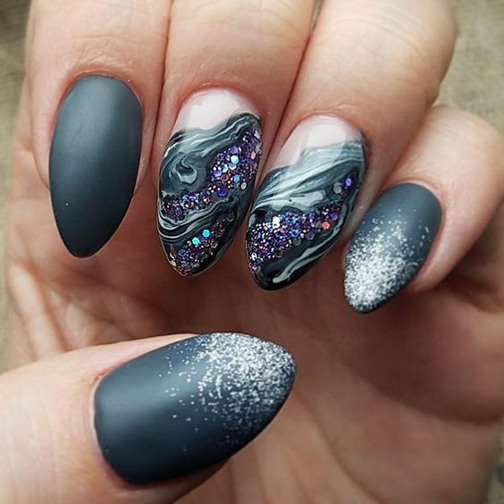 black nails with silver glitter and amethyst and marble detailing