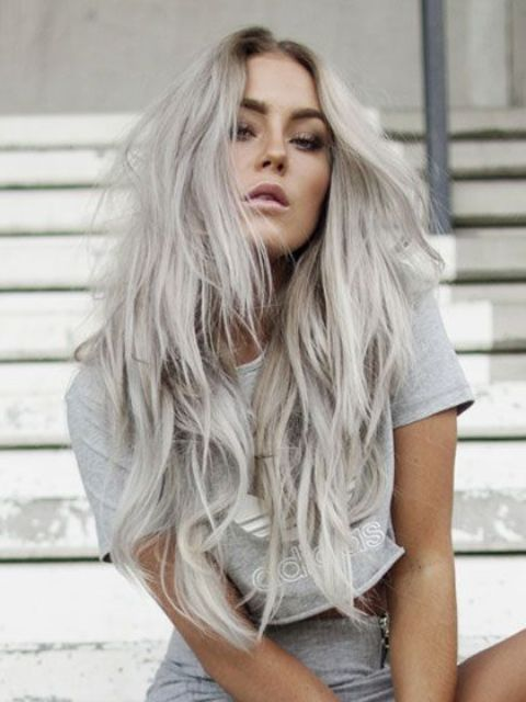 long blonde grey hair with waves and a cool hair cut