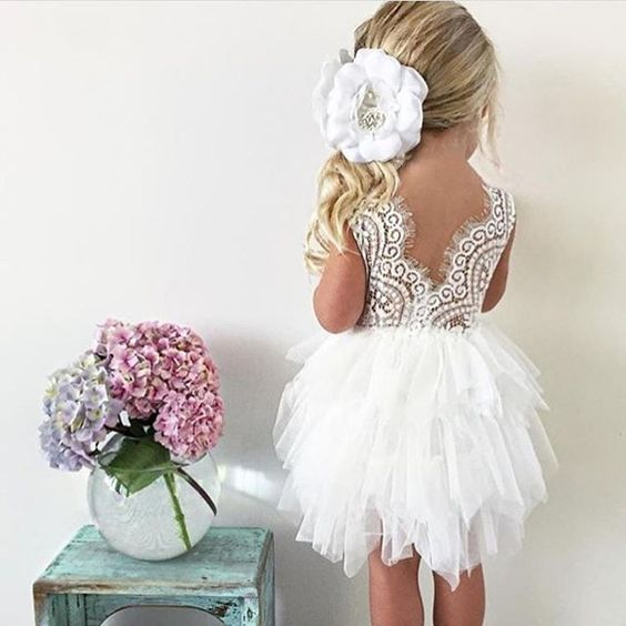 a knee dress with a feather-inspired skirt and a lace bodice with a V cut