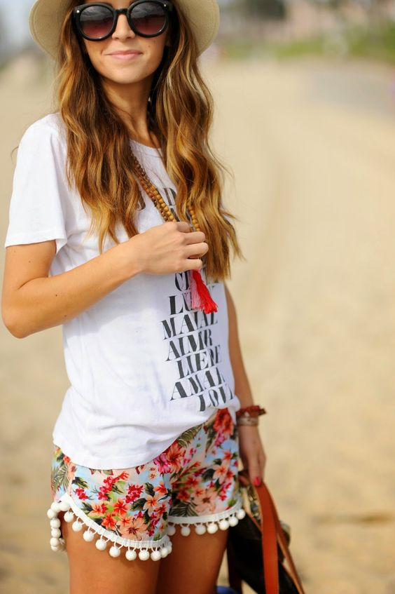 a printed tee, floral shorts with a pompom trim