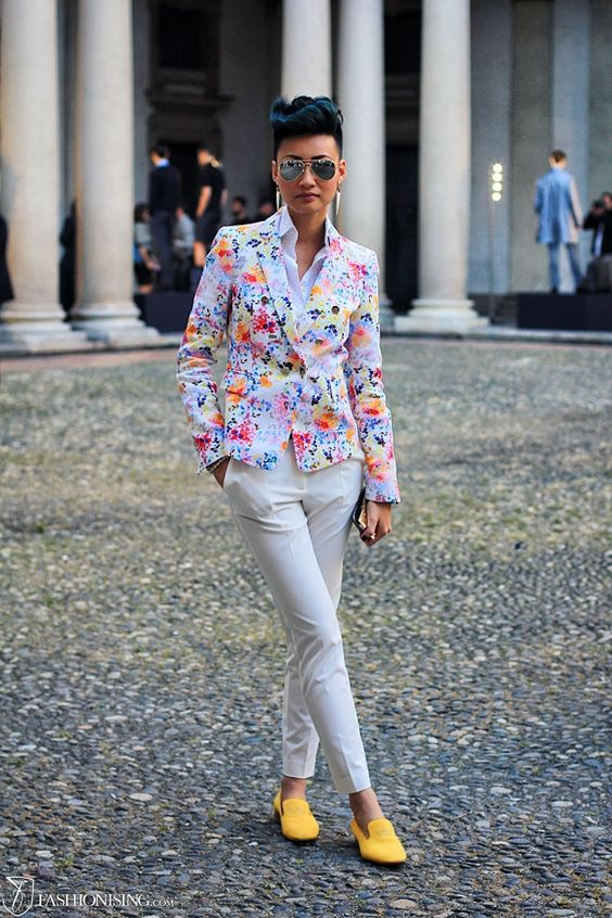 white pants, a white shirt, a bold blazer and yellow moccasins