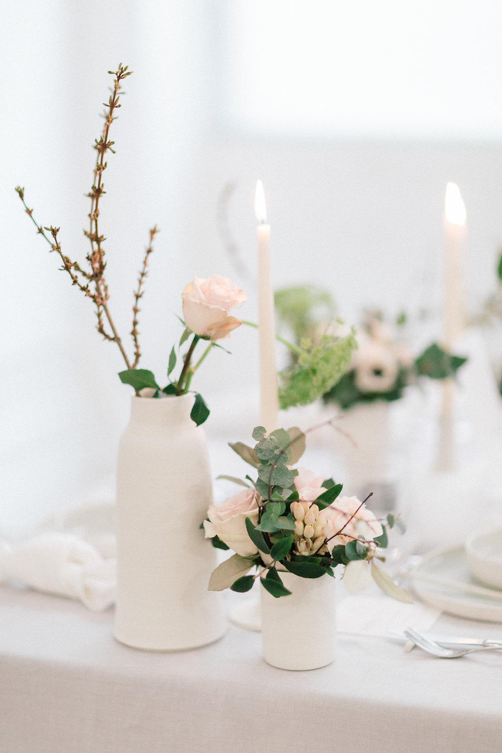 romantic bud vase centerpieces - photo by Julien Bonjour Photographe http://ruffledblog.com/airy-industrial-wedding-inspiration-for-spring