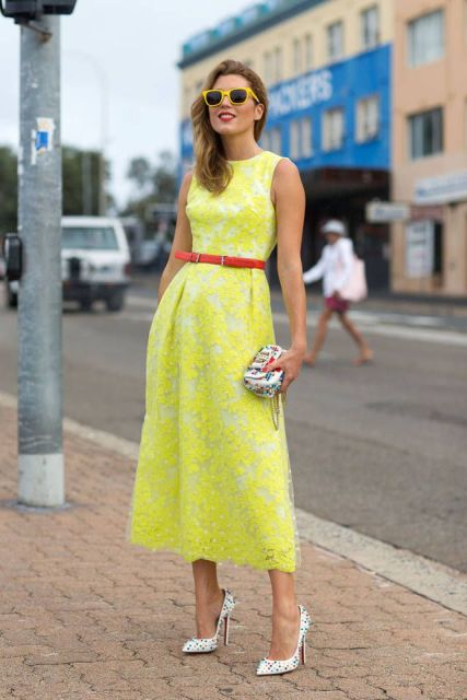 With red belt, printed mini clutch and polka dot shoes