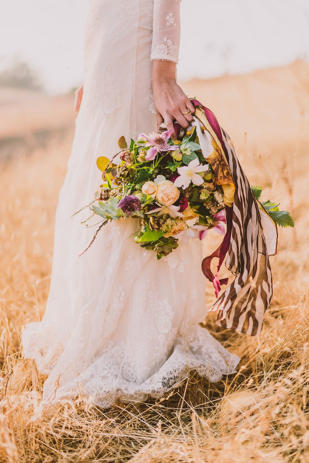 wedding bouquets with burgundy ribbons - photo by Michelle Roller http://ruffledblog.com/wild-safari-inspiration-shoot-with-a-jeep