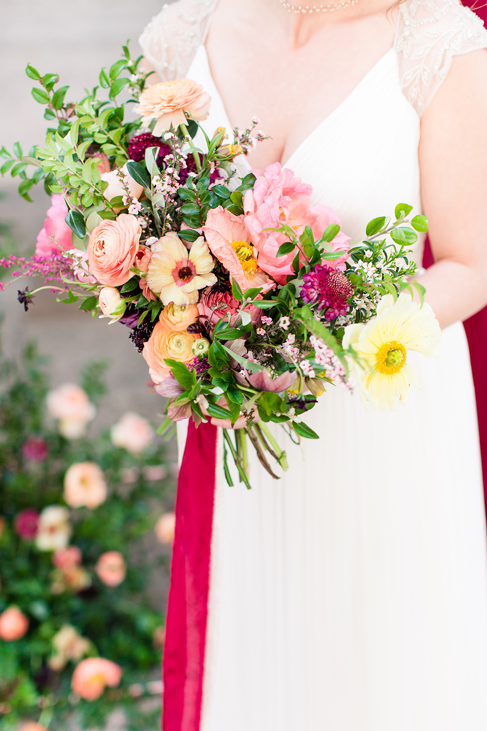 pink and yellow bouquets - photo by Lauren Lee Photography http://ruffledblog.com/modern-grecian-inspired-wedding-ideas