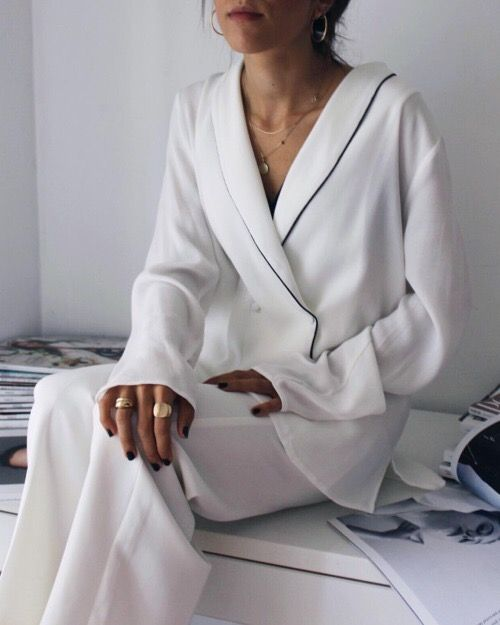 white silk pajamas with a black trim feels and looks awesome