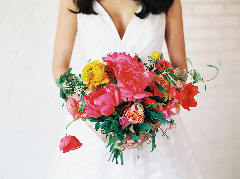 pink modern bouquets - photo by Jessica Gold Photography http://ruffledblog.com/vibrant-summer-wedding-inspiration-with-fun-colors