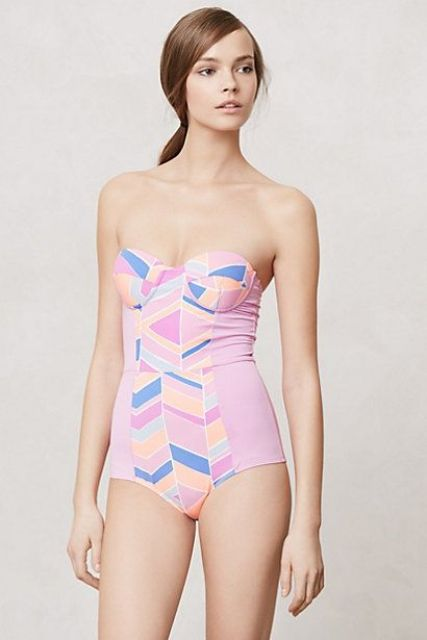 pink one piece swimsuit with geometric decor and a strapless top