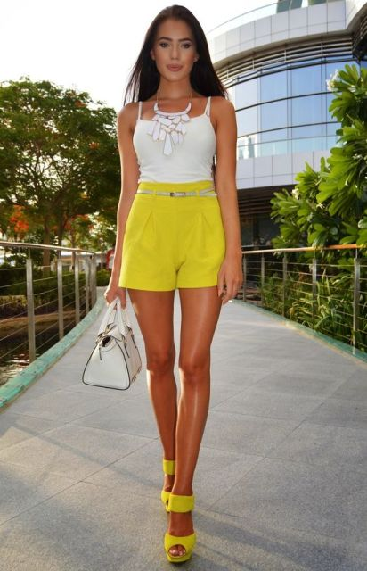 With white top, yellow sandals and white bag