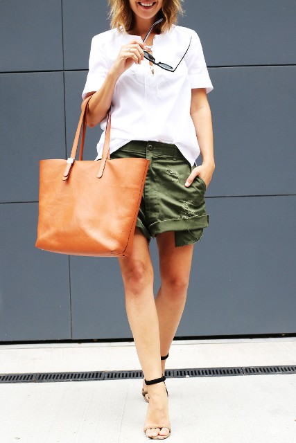 With white shirt, two color heels and brown tote