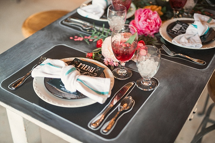 Each table setting was done with a chalkboard placemat and menu, the table itself was also chalkboard