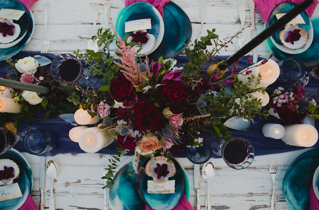 Colorful and moody floral centerpiece | Just For Love Photography