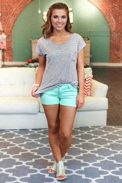 With gray t-shirt and mint shoes
