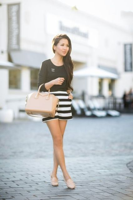With striped shirt, nude flats and nude bag