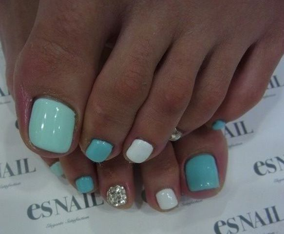 turquoise, aqua, white and silver nails can be rocked at a beach party