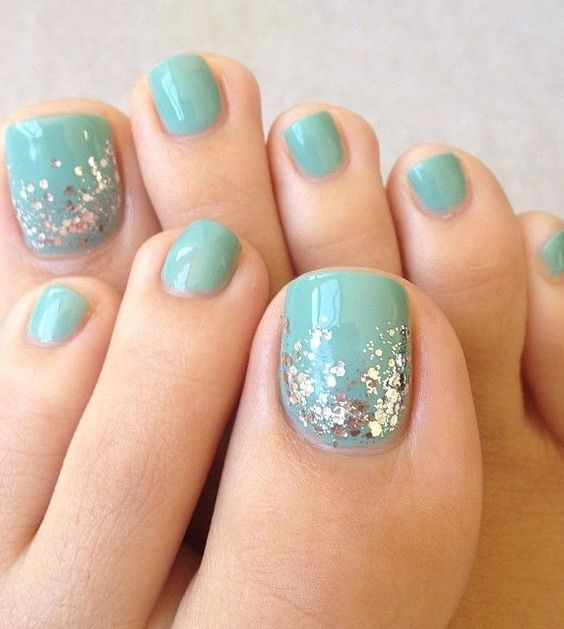 aqua-colored nails with silver sequins for a cool glam look